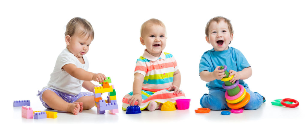 Infant Daycare nursery babies play with educational toys - Preschool & Daycare Serving Berlin, Northboro & Clinton MA