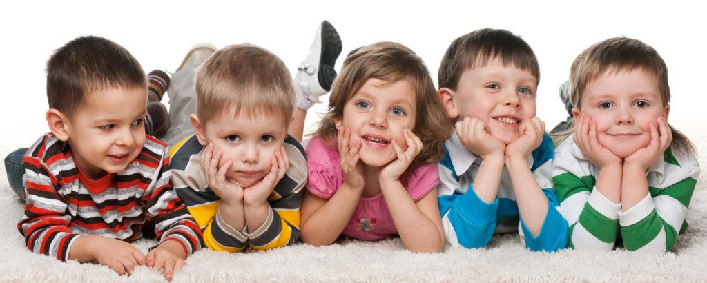 Summer Program - Five children lying on the carpet - Preschool & Daycare Serving Berlin, Northboro & Clinton MA